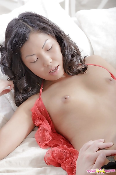 Young Asian girl goes ass to..