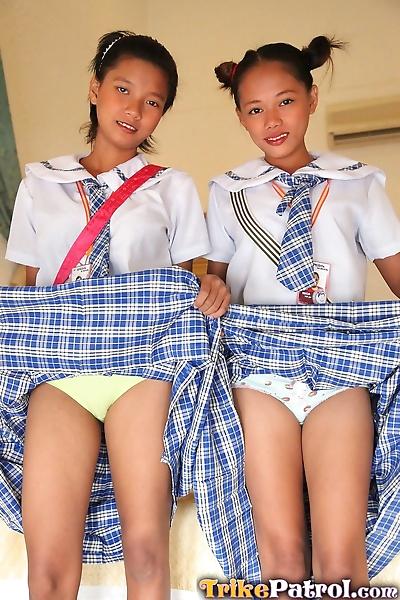 Young Asian schoolgirls lift..