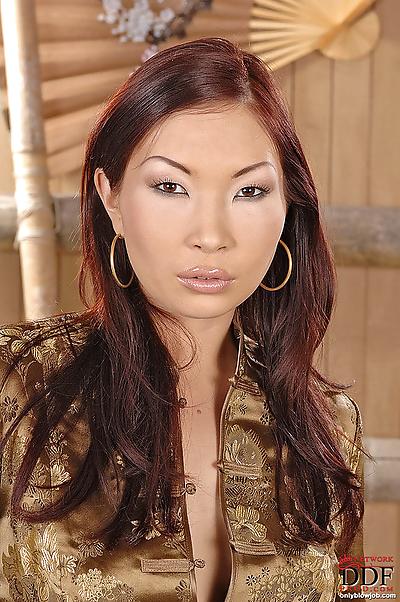 Asian slut with huge tits..