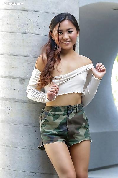 Petite Asian teen Elle..