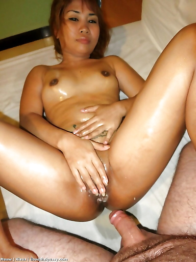 Petite Asian redhead with..