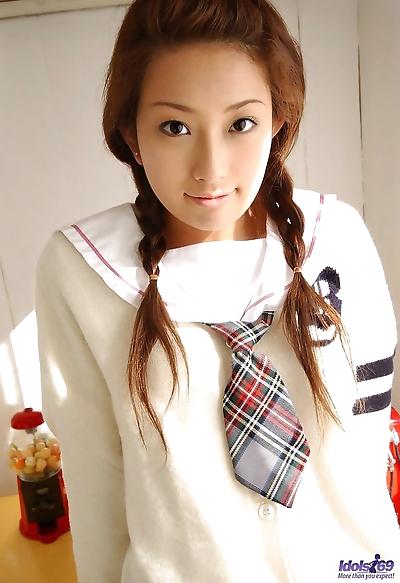 Cute Japanese schoolgirl Nao Yoshizaki removes cute panties to show her bush