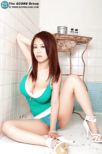 Busty beautiful Asian strips to her lace panties revealing massive big boobs