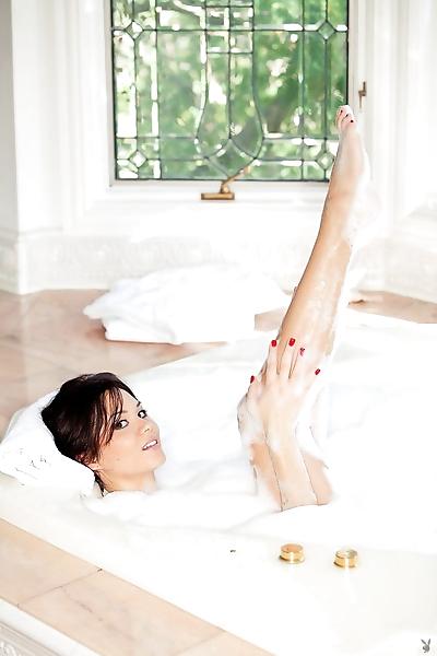 Erotic model Jennie Reid sheds sheer lingerie to wet big tits in the bathtub