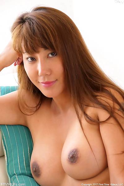 Hot oriental chick Tiffany wets her huge boobs and hot ass in the bath tub